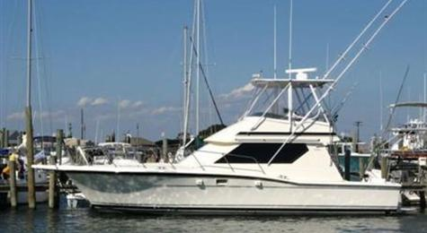 The impressive range includes Hatteras Yachts 90 Convertible, ...