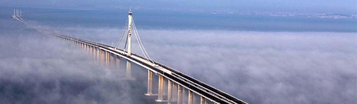 China's Jiaozhou Bay Bridge (or Qingdao Haiwan Bridge) is listed by  Guinness World Records, as from 2012, as the world's longest bridge over  water ...